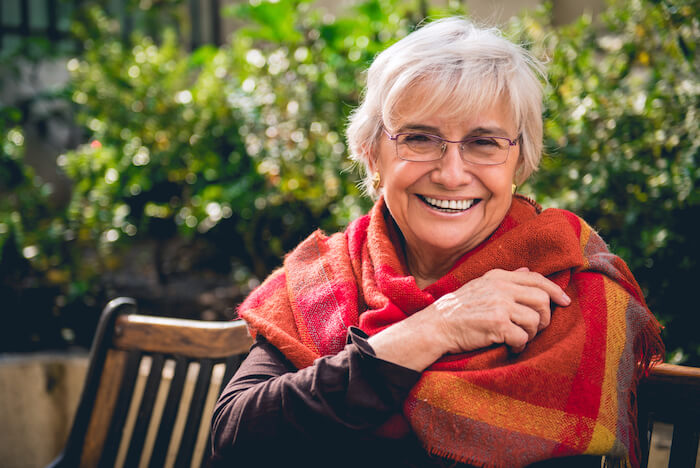 Senior woman with bright scarf wrap