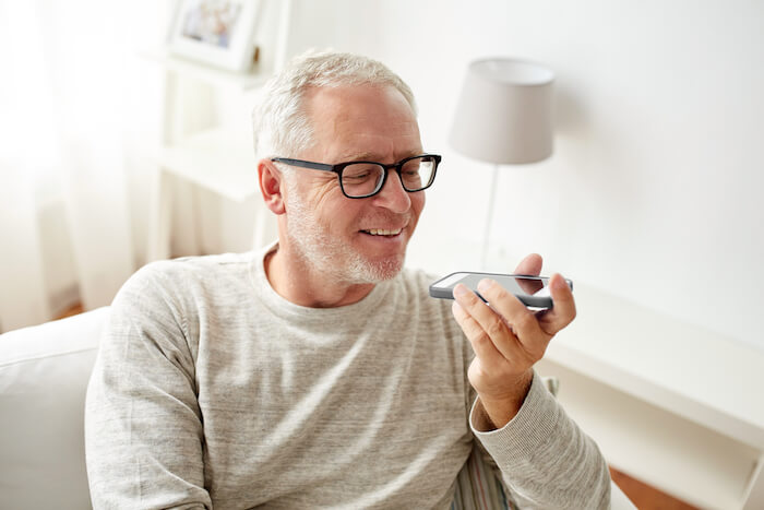 Older man wearing glasses and talking on phone