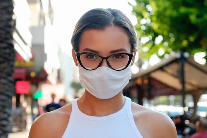 Woman wearing mask and trendy glasses