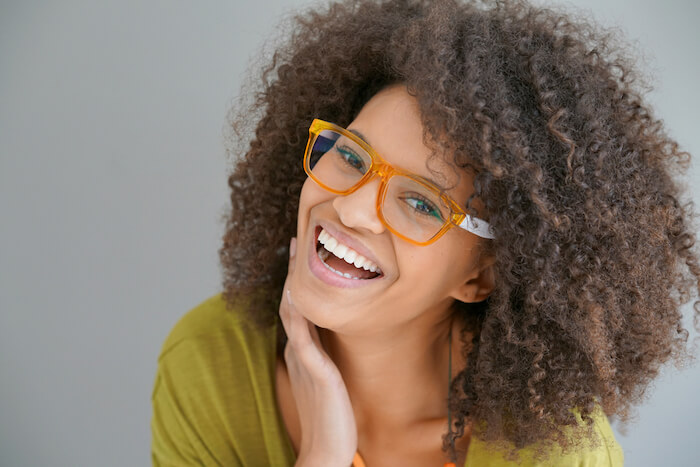 Young woman wearing trendy orange glasses
